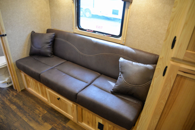 Sofa in a C8XHSLBP12SE Charger Bumper Pull Horse Trailer | Lakota Trailers