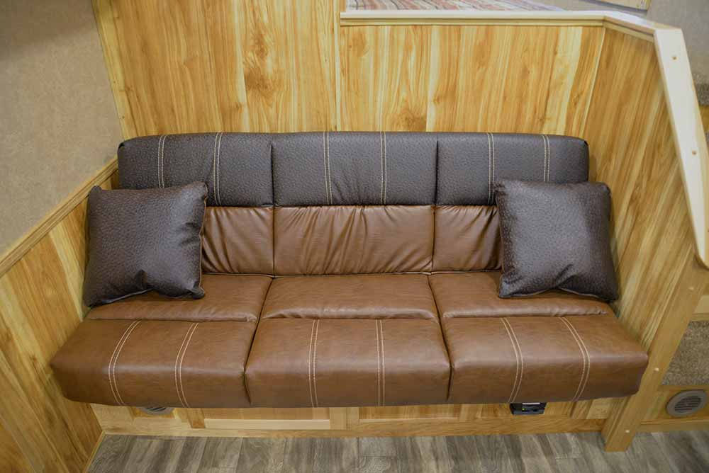 Sofa on Riser in Charger C8X15SRB | Lakota Trailers
