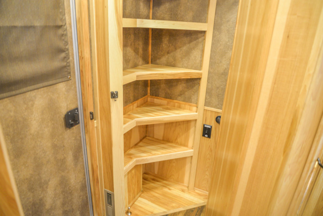 Pantry in a BH8X15FKP Big Horn Edition Horse Trailer | Lakota Trailers