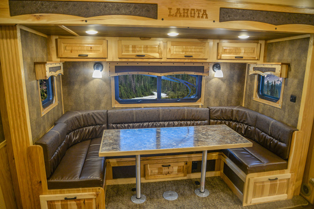 Dinette in a BH8X15FKP Big Horn Edition Horse Trailer | Lakota Trailers