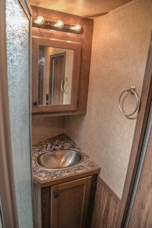 Bathroom in a C8X13SR Charger Edition Horse Trailer | Lakota Trailers