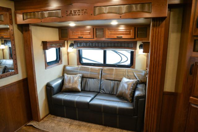 Sofa in a BH8X11RK Big Horn Edition Horse Trailer | Lakota Trailers