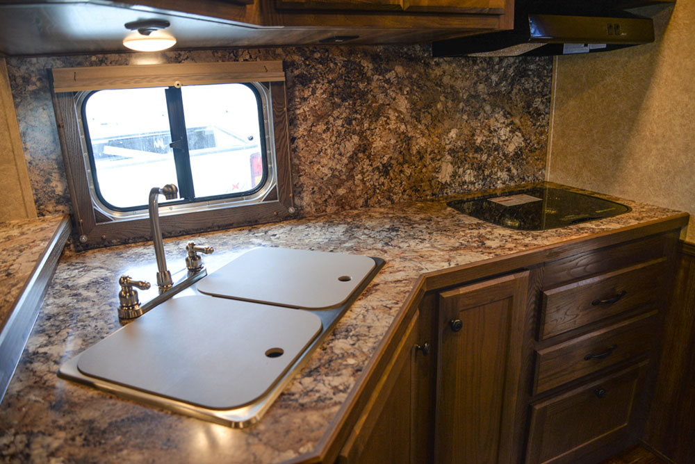 Kitchen in a C8X13RKB Charger Edition Horse Trailer | Lakota Trailers