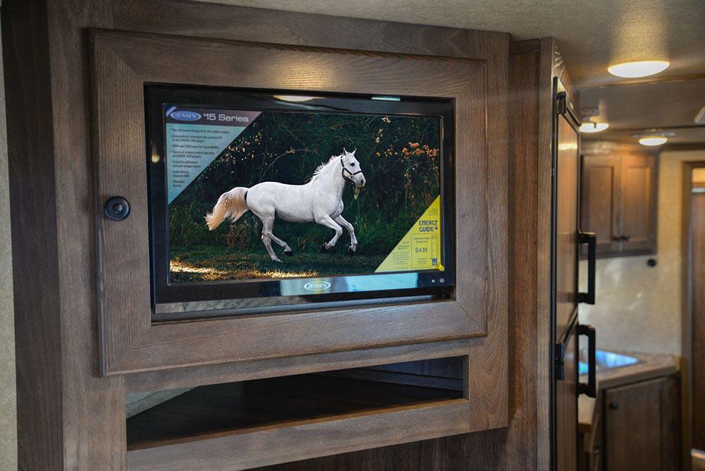 TV in Gooseneck in LE8X11RK Charger Edition Livestock Trailer | Lakota Trailers