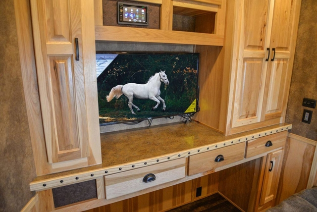 TV in Second Bedroom in BH8X23T2S Bighorn Edition Horse Trailer | Lakota Trailers