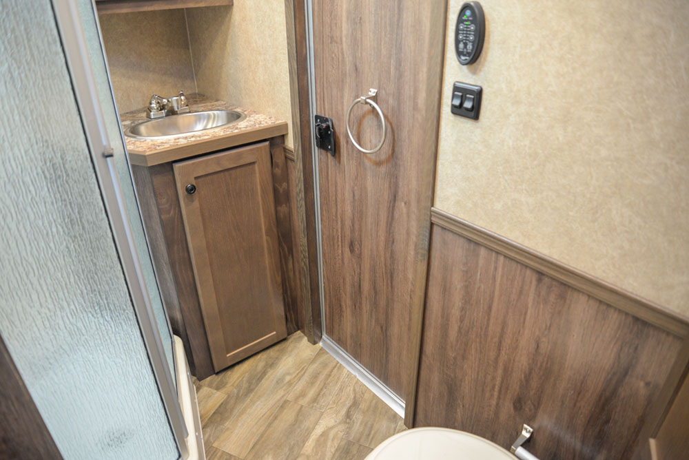 Bathroom in a LE8X11RK Charger Edition Livestock Trailer | Lakota Trailers