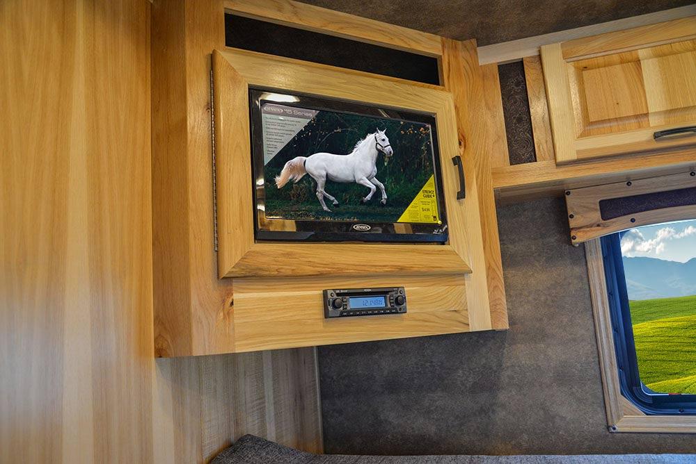 TV in Bedroom in Gooseneck in BH8X23T2S Bighorn Edition Horse Trailer | Lakota Trailers
