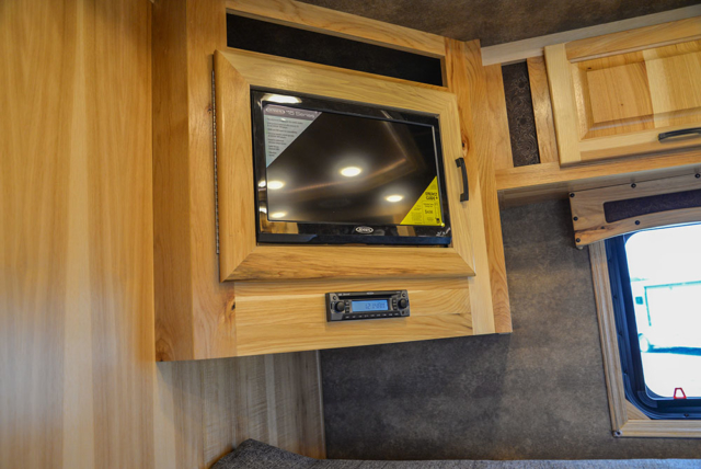 Bedroom Entertainment System in a BH8X23T2S Bighorn Edition Horse Trailer | Lakota Trailers