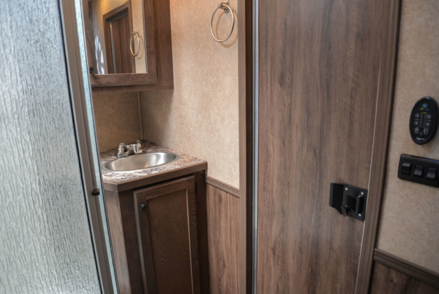 Bathroom in a C8X13RKB Charger Edition Horse Trailer | Lakota Trailers